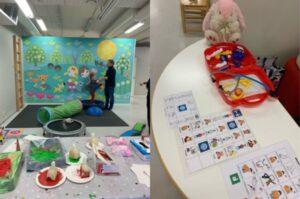Värikäs leikkipaikka lapsille ja nalleneuvolan pöytä.