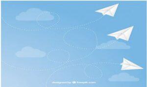 Piirroskuva, jossa paperilentokoneet lentävät sinisellä taustalla.